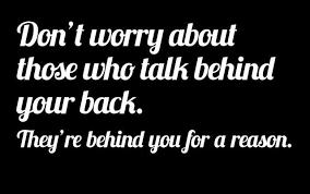 behind back